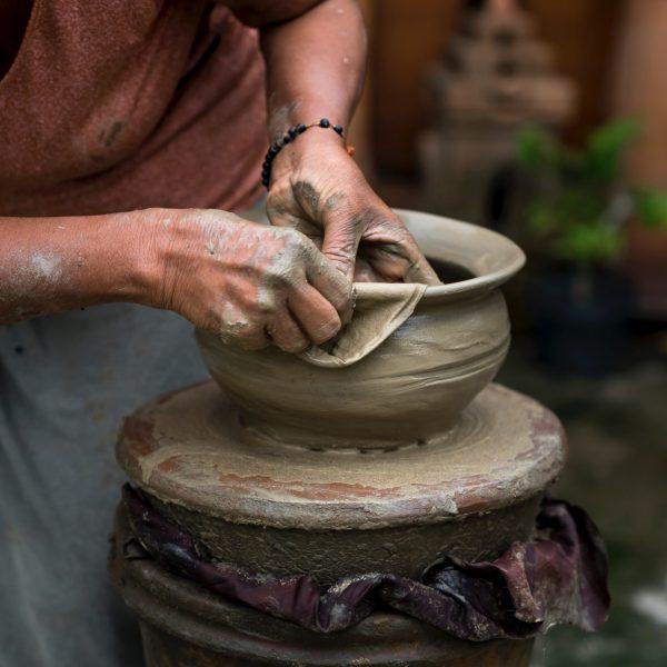 woman-making-clay-pot-2166456